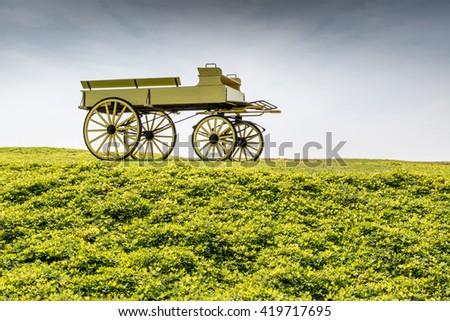 A uncovered wagon retro style in beautiful nature scene farmland. - stock photo