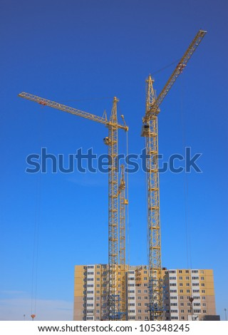 A under construction house on a background of the blue sky - stock photo