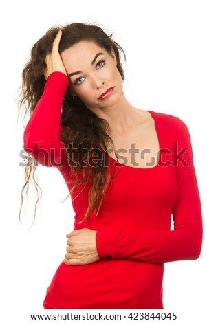 A unhappy beautiful woman who is  having a bad hair day. Isolated on white - stock photo