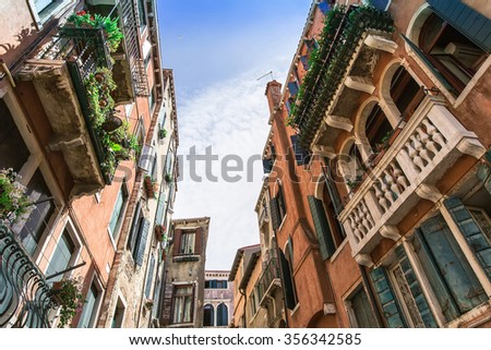 A unique canal among old colorful brick houses in Venice, Italy. - stock photo