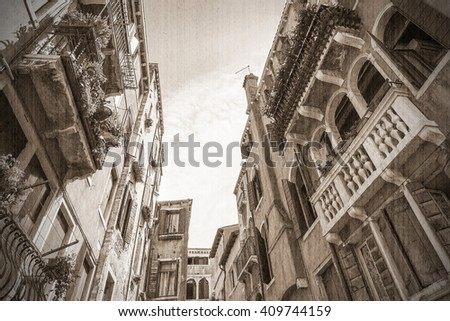 A unique canal among old colorful brick houses in Venice, Italy. Old style. Sepia - stock photo