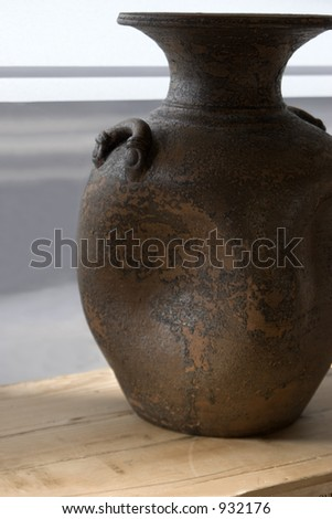 A unique shaped clay pot for transporting oil, wine, water and other liquids.  Mediterranean overtones. - stock photo