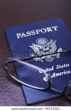 A United States of America Passport with a pair of glasses - stock photo