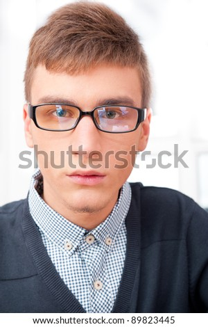A university college student or casual good looking man wearing glasses portrait. Looking At camera