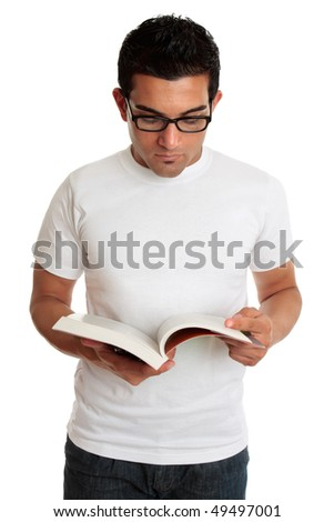 A university college student or casual man reading or studying a textbook. - stock photo