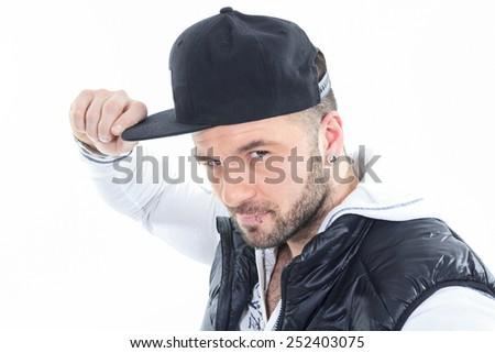 A Urban man wearing baseball cap over white background studio. - stock photo
