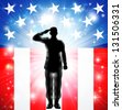 A US military armed forces soldier in silhouette saluting in front of an American flag background - stock photo