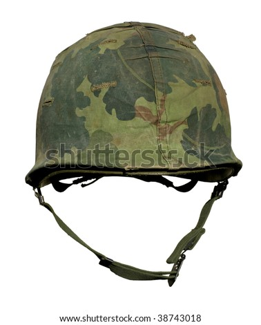 A US military helmet with an M1 Mitchell pattern camouflage cover from the Vietnam war. - stock photo