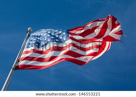 A USA flag flies in a strong wind in Louisiana, USA - stock photo