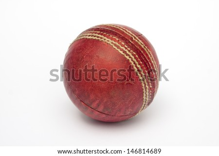 A used cricket ball isolated on white - stock photo