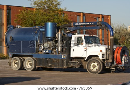 A Vacuum truck. - stock photo