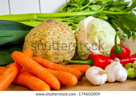 a variation of fresh vegetables on kitchen countertop - stock photo