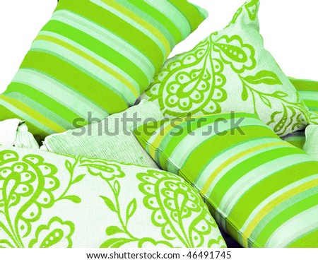 a Variation of lime green cushions - stock photo