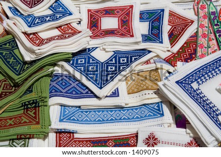 A varied set of Croatian cloth being sold as souvenirs to tourists. - stock photo