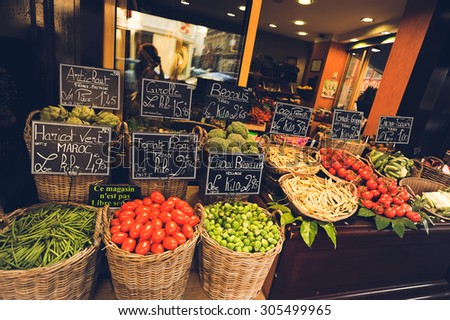 a variety of beautiful and colorful vegetables and fruits on counter market shop street - stock photo