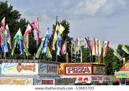 A variety of carnival food vendors on the midway - stock photo