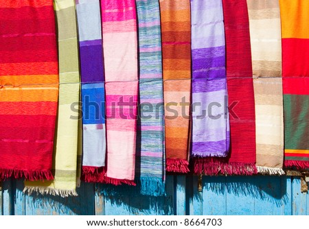 A variety of colored cloths and silks from Northern Africa. Morocco, Essaouira. - stock photo