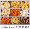 A variety of crunchy snacks in a box - stock photo