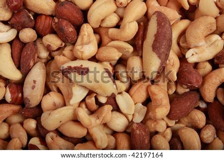 A variety of fresh mixed nuts closeup - stock photo