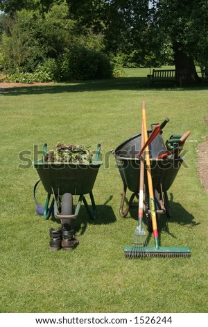 A variety of gardening tools in two wheel barrows - stock photo