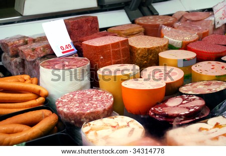 a variety of german sausage products in cooling shelf - stock photo