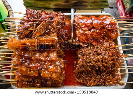 A variety of grilled squid with skewer - stock photo