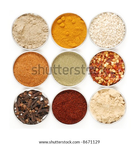 a variety of herbs and spices in metal containers - isolated on white background - stock photo