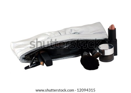 a variety of makeup with a silver case on a white background