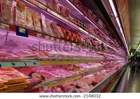 A variety of meats at a grocery store. - stock photo