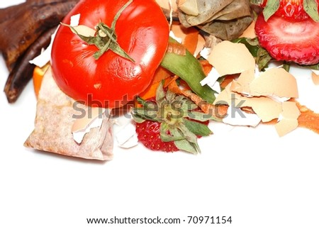 A Variety of Organic Fruit and Vegetable Scraps in a Compost Pile On White, with Room for Text Below - stock photo