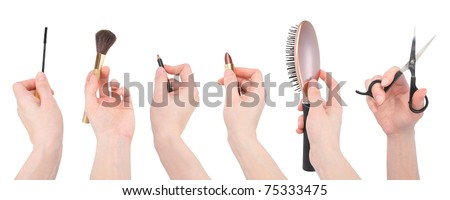 A variety of salon and makeup objects on an isolated white background. Hands are holding mascara, eyeliner, lipstick a brush and scissors. - stock photo