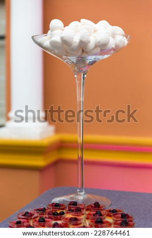 A variety of tasty candies in cliche candy jar. - stock photo