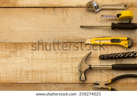 A variety of tools on wood. Advertising space