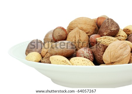 A variety of whole mixed nuts in the shell against a white background. Clipping path included. - stock photo
