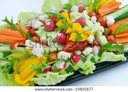 A vegetable dish with carrot, radish, cauliflower, lettuce, paprika, cucumber, iceberg lettuce - stock photo