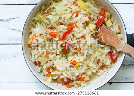 a vegetable ragout of cabbage, carrots, potatoes, peppers and zucchini - stock photo