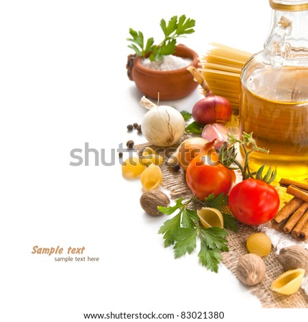 A vegetables, spices and pasta with olive oil on the table - stock photo