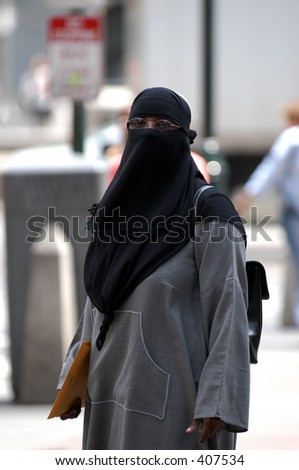 A veiled woman in the city - stock photo