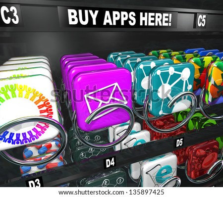 A vending machine with the words Buy Apps Here and many app tiles and icons ready to be bought and downloaded to your smart phone, tablet computer or other mobile electronic device - stock photo