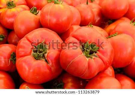 A vendor sales fresh organic heirloom tomatoes at a farmers market in Oregon - stock photo