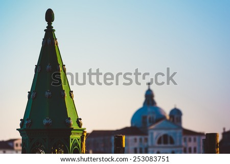 A Venetian Lantern with Santa Maria della Salute Basilica on the background at the sunset - stock photo