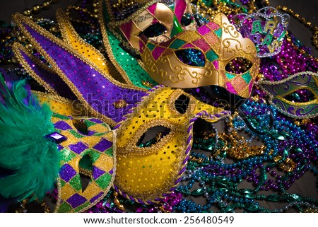 A venetian, mardi gras mask or disguise on a dark background - stock photo