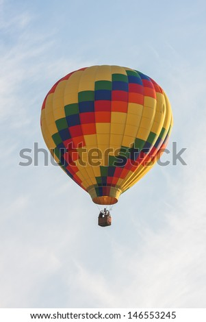 A vertical image of a single hot air balloon.
