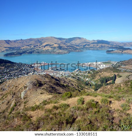 A vertical panoramic view of Lyttleton Port and Harbour on an autumn morning from the Gondola at the top of the Port Hills, Christchurch, New Zealand. In the background is Diamond Harbour. - stock photo