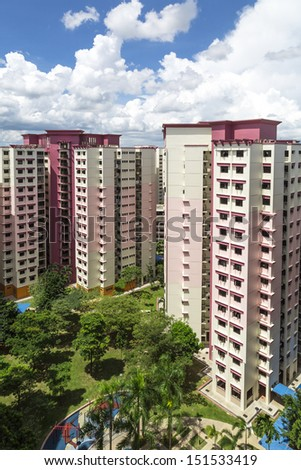 A vertical shot of a pink estate with park and playground.