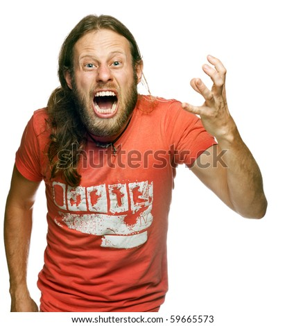 A very angry man screaming and gesturing - stock photo