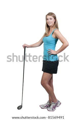 A very beautiful and young woman golfer - stock photo