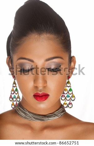 A very beautiful portrait of a woman with her eyes closed displaying lovely eyelashes - stock photo