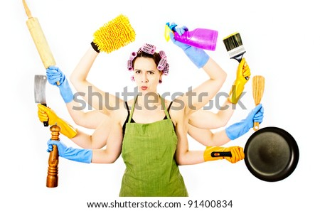 A very busy multitasking housewife looking a little skeptical - stock photo