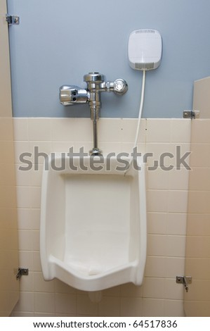 A very clean urinal in a bathroom - stock photo